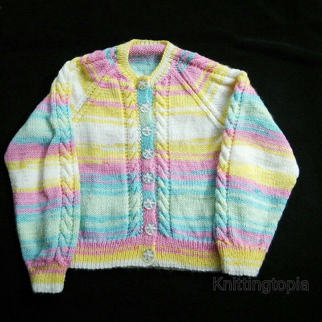Hand knitted baby cardigan in multicoloured yarn with cable detail