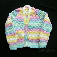 Hand knitted baby cardigan in multicoloured yarn with all over honeycomb pattern
