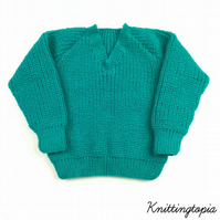 Children's jumper hand knitted in green with all over textured pattern