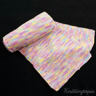 Hand knitted long and wide scarf in pastel tones