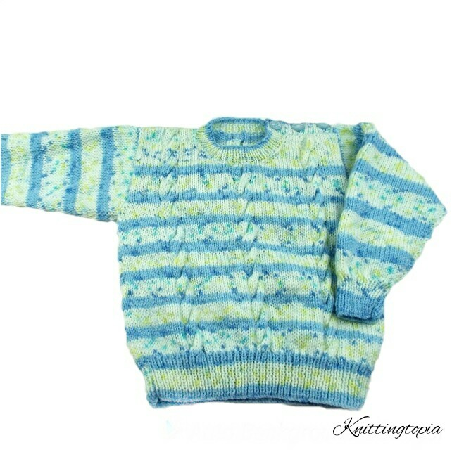 Children's jumper hand knitted in blue and cream with cable pattern 2 - 3 yrs