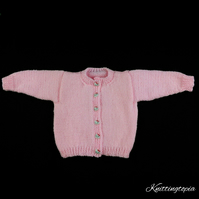 Hand knitted baby girl cardigan in pale pink 0 - 3 months