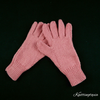Hand knitted ladies gloves in coral pink orange yarn