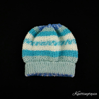 Hand knitted baby Aran ribbed hat in blue and cream mix 17 inch head 6 months