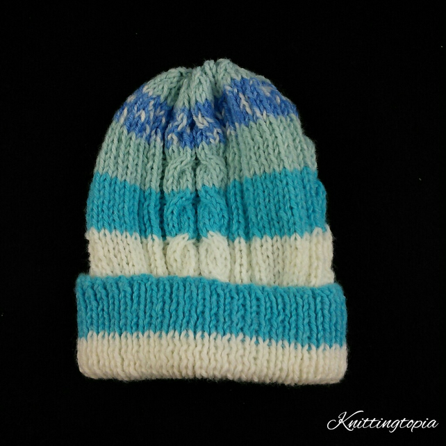 Hand knitted baby Aran cable hat in blue and cream mix 15 inch head 3 months