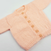 Hand knitted peach baby girl cardigan  0 - 3 months round neck