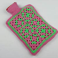 Hand crocheted granny square hot water bottle cover green and pink