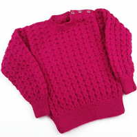 Hand knitted baby girl cable jumper sweater in hot pink to fit 2 - 3 years