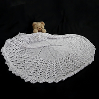 Hand knitted circular lacy baby shawl white with pink blue and lilac spots