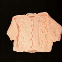 Hand knitted baby girls peach cardigan with cable pattern 1 - 2 yrs