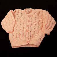 Hand knitted baby cardigan to fit 20 inch chest - peach - lacy pattern - knitted