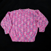 Hand knitted baby jumper in purples and pinks 6 - 12 months