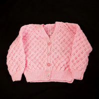 Hand knitted baby v neck cardigan knitted in pink 24 inch chest