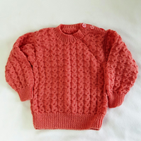 Hand knitted baby girl jumper in deep pink to fit 12-18 months