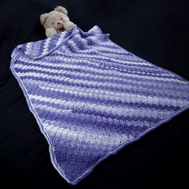 Hand crocheted baby cot size purple c2c blanket in sparkly yarn