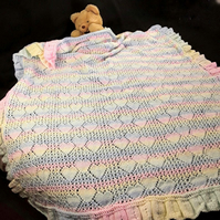 Hand knitted large baby shawl with hearts in pastel stripes