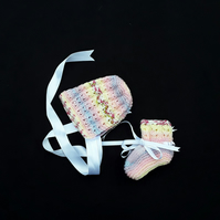 Hand knitted pink multicoloured baby bonnet and booties set 0 - 3 months