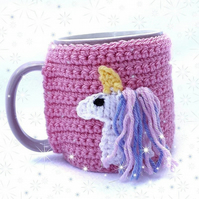 Hand crocheted mug cosy - pink with white unicorn with pink and blue sparky mane
