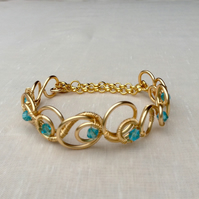 Aqua  Blue Crystal Gold  Circle Bracelet.   Narrow Cuff.   Adjustable Bracelet