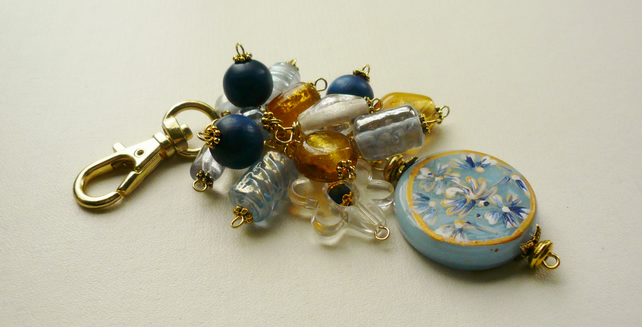 Pale Blue and Gold Glass Bead Gold Tone Bag Charm   KCJ1060
