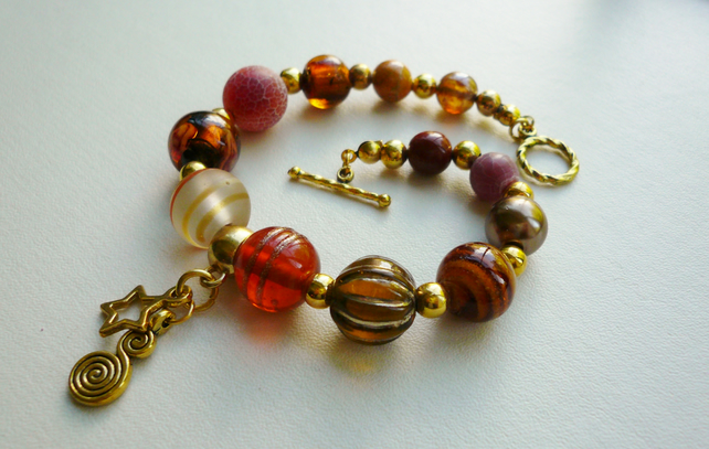Amber Caramel Coloured Mixed Bead Gold Tone Star Charm Bracelet   KCJ612