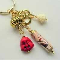 Red Howlite Gold Plated Buddha Ohm Symbol Keyring   KCJ2307