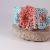 Crochet cuff with three floral blooms in aqua, peach and mauve - Annys