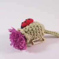 Brooch - crochet thistle and handstitched felt ladybird
