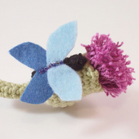 Crochet thistle and felt butterfly brooch in green, blue and purple