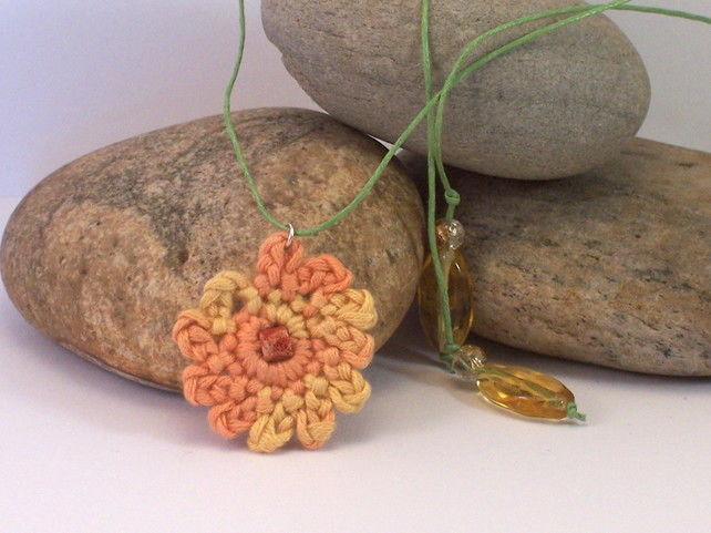 Crochet carnation necklace in orange, yellow and green - naomi