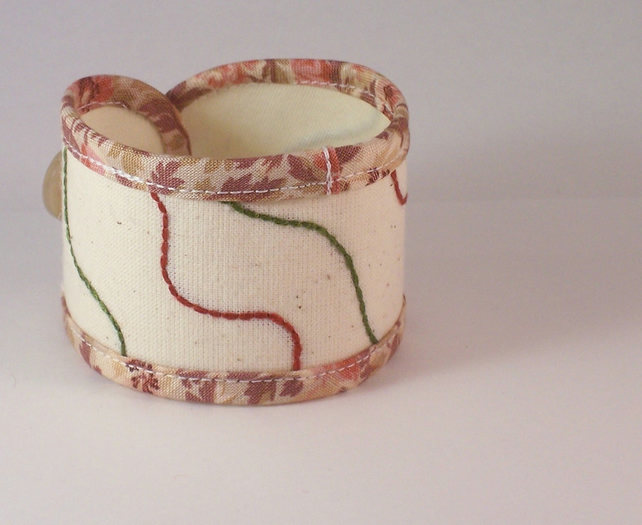 Hand embroidered fabric cuff - Lay lines