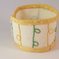 Hand embroidered textile cuff - bubbleline