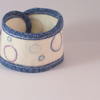 Hand embroidered soft fabric cuff in cream and blue - Circles