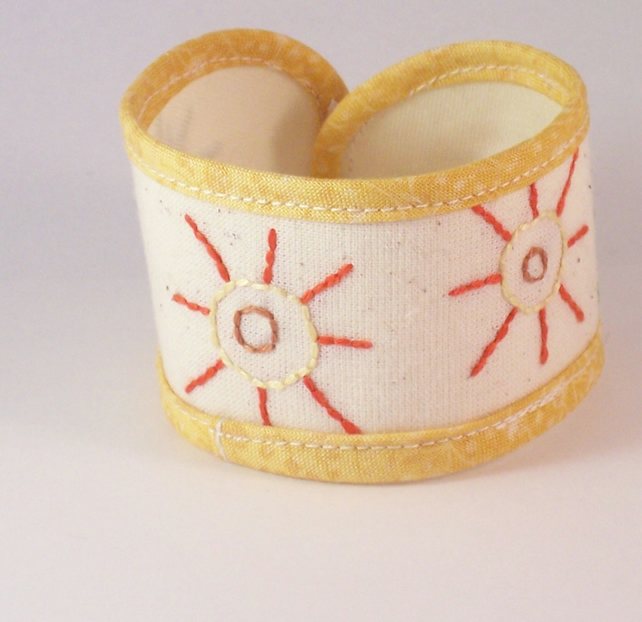 Hand embroidered textile cuff in yellow and cream - Sunbeam