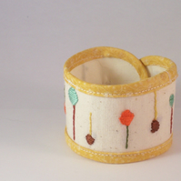 Lollipop tree embroidered cuff in yellow and cream