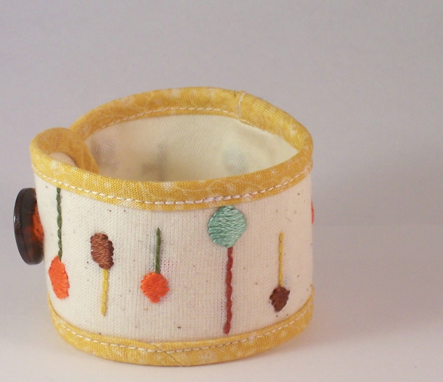 Hand embroidered textile cuff in summery yellow and cream - Lollipop tree