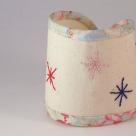 Star embroidered cuff in pink, blue and cream