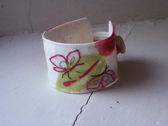 Poppy fabric cuff with hand embroidered butterflies