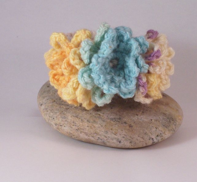 Crochet cuff with flower blooms in aqua, lemon and mauve - Gracie