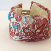 Hand stitched linen cuff in rust with turquoise embroidery - Azure