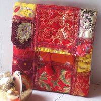 Asia - small textile art fabric clutch bag in orange, red and yellow