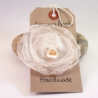 Burned organza and shell brooch