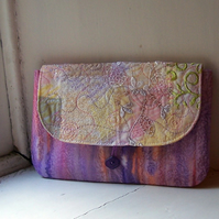 Machine and hand embroidered textile clutch bag with button fastening - Pissarro
