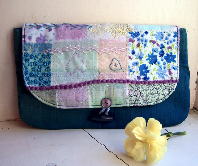 Textile clutch bag in teal silk with hand and machine embroidery - Catmint