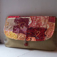 Clutch bag in antique gold with one of a kind textile flap - Canna