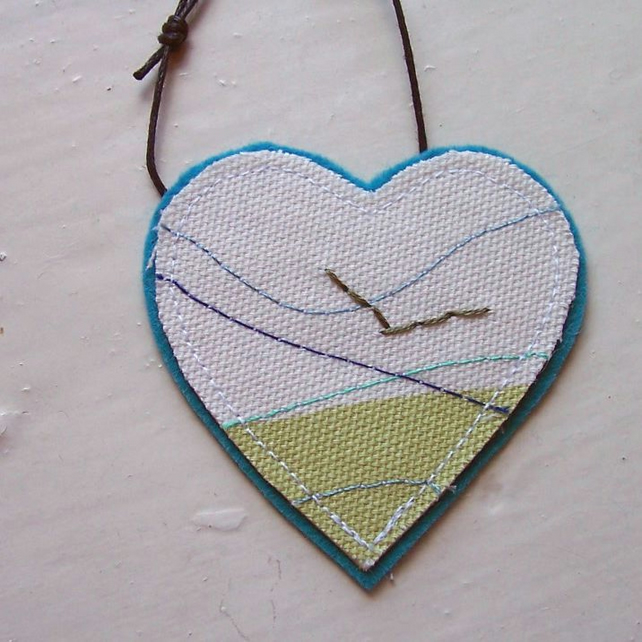 Textile necklace, heart shaped, hand and machine embroidered  - Gannet