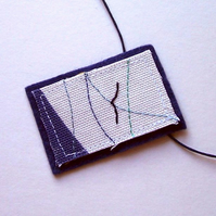 Hand and machine embroidered textile necklace - Kittiwake