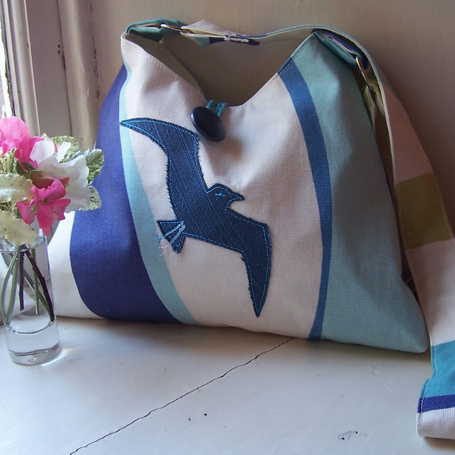 Soft textile shoulder bag with machine embroidered bird applique - Gull