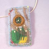 Felted and hand embroidered necklace - marsh marigold