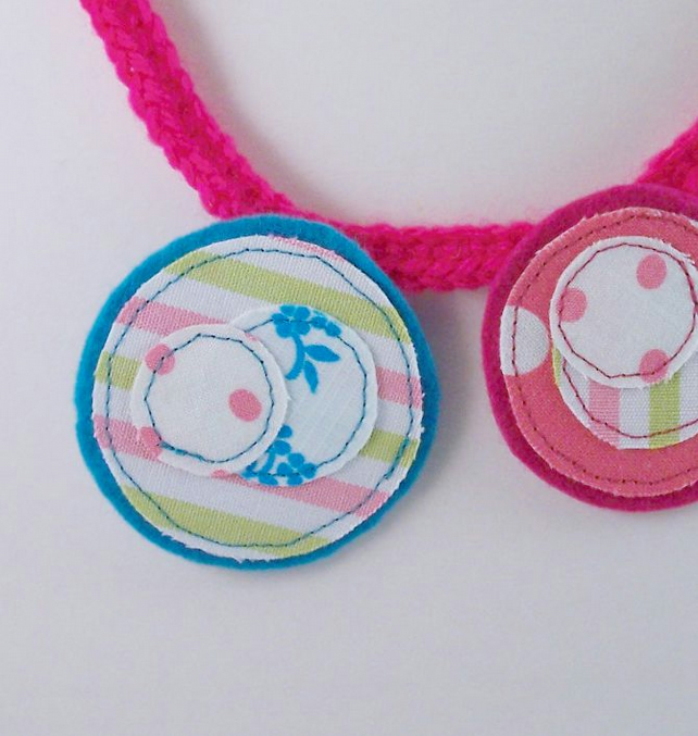 Smile - crochet and fabric necklace with button fastening